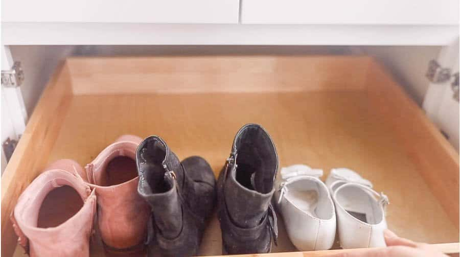 pull out drawers in a farmhouse mudroom cabinet for shoe storage