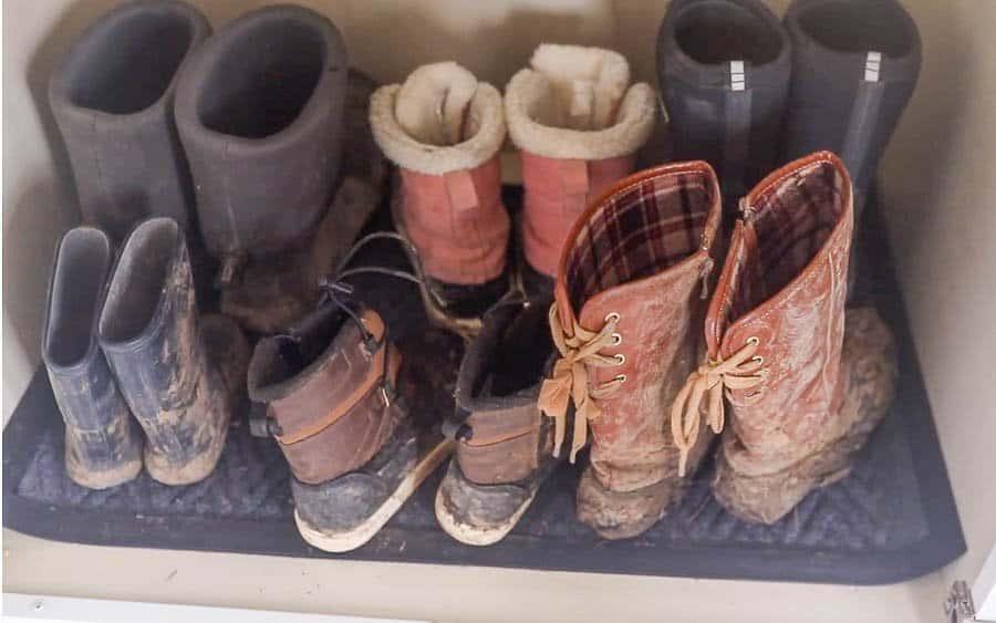 muddy winter boots on a mat