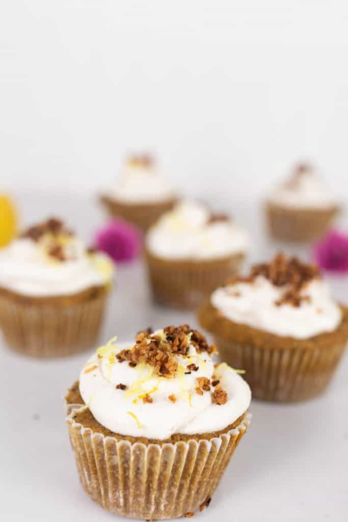 lemon poppy seed muffins with whipped cream, lemon zest and toasted coconut.