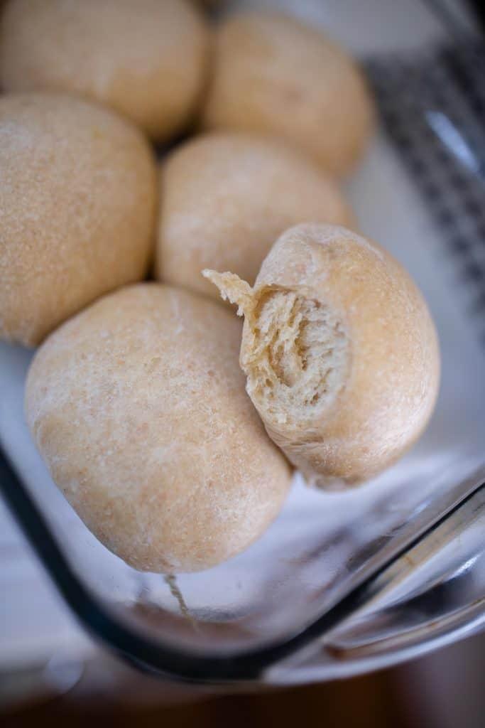 sourdough rolls in a glass baking dish