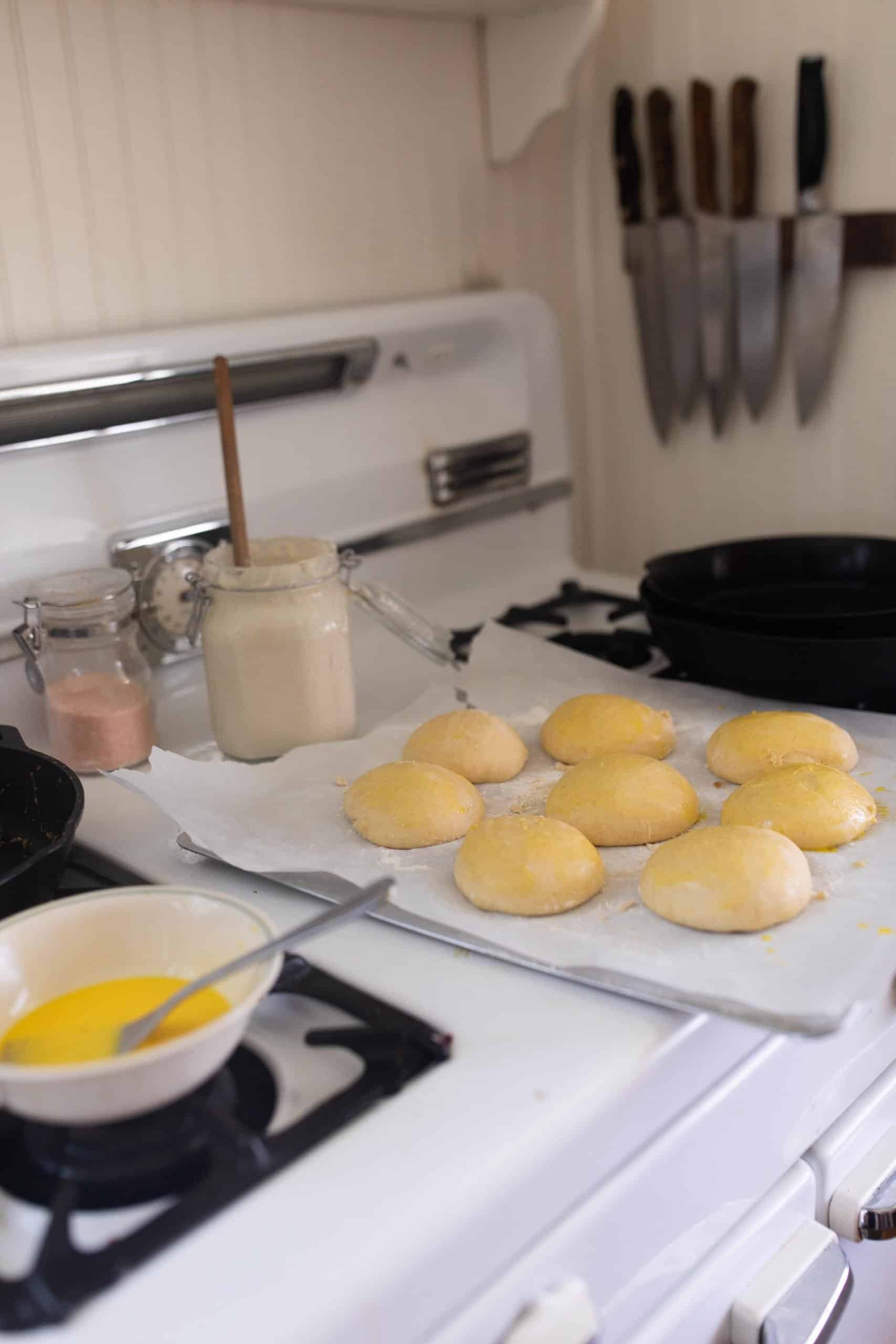 egg wash being added to homemade sourdough buns