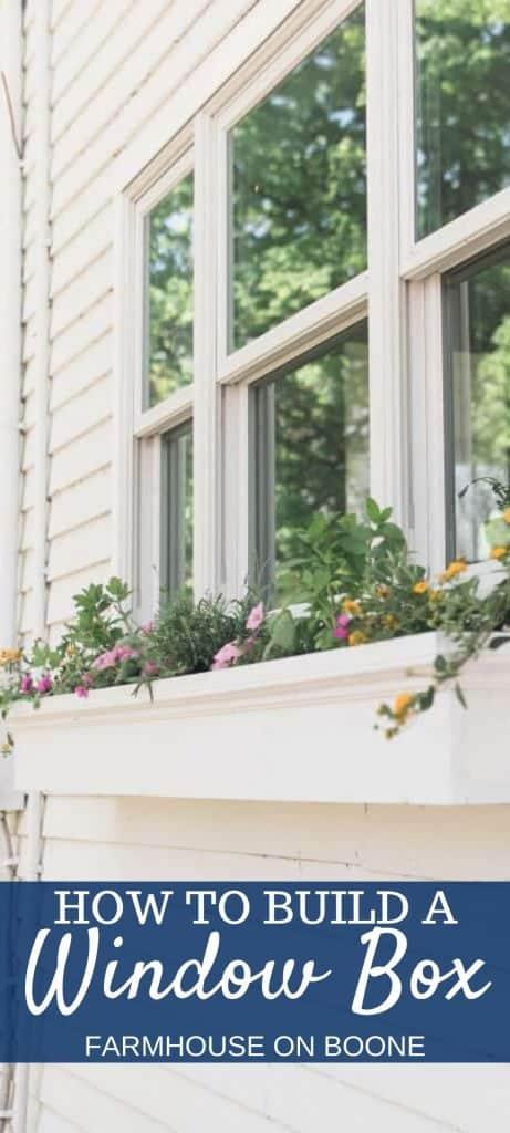 pinterest image of a white diy window box full of flowers