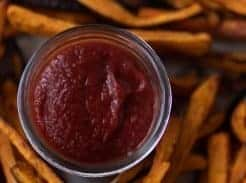 close up overhead photo of fermented ketchup in the middle of sweet potato fries