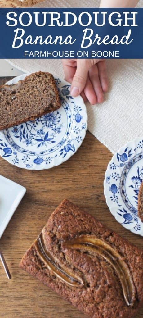 long Pinterest image of hand reaching to pick up a blue and white plate with a slice of sourdough banana bread on it. half a loaf of banana bread is in front of the plates on a table