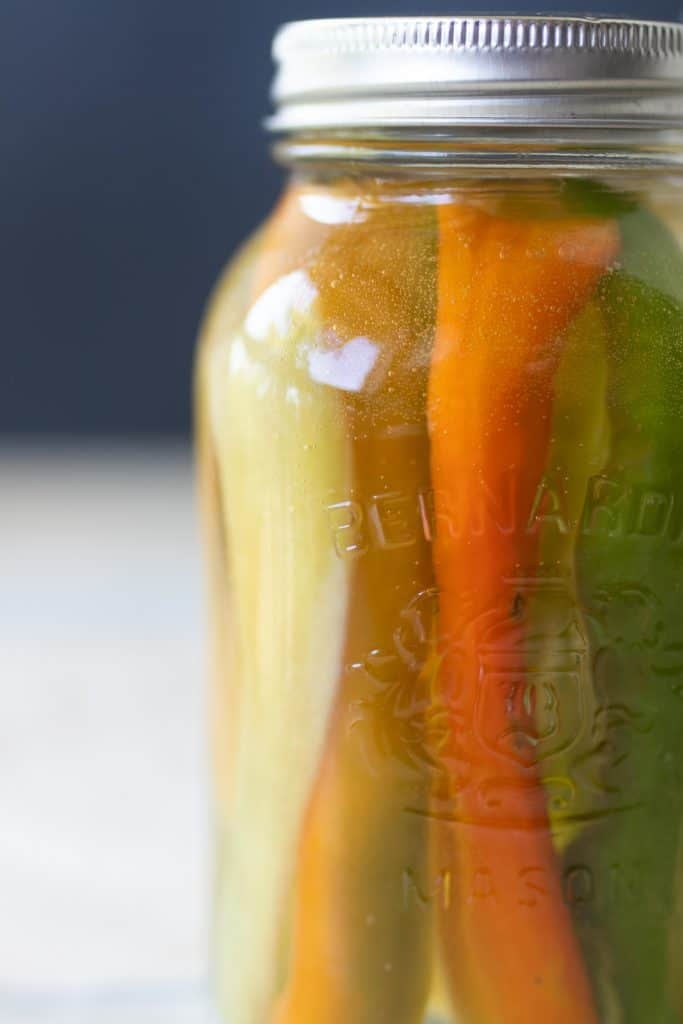 close up picture of fermented peppers in a jar to make fermented hot sauce