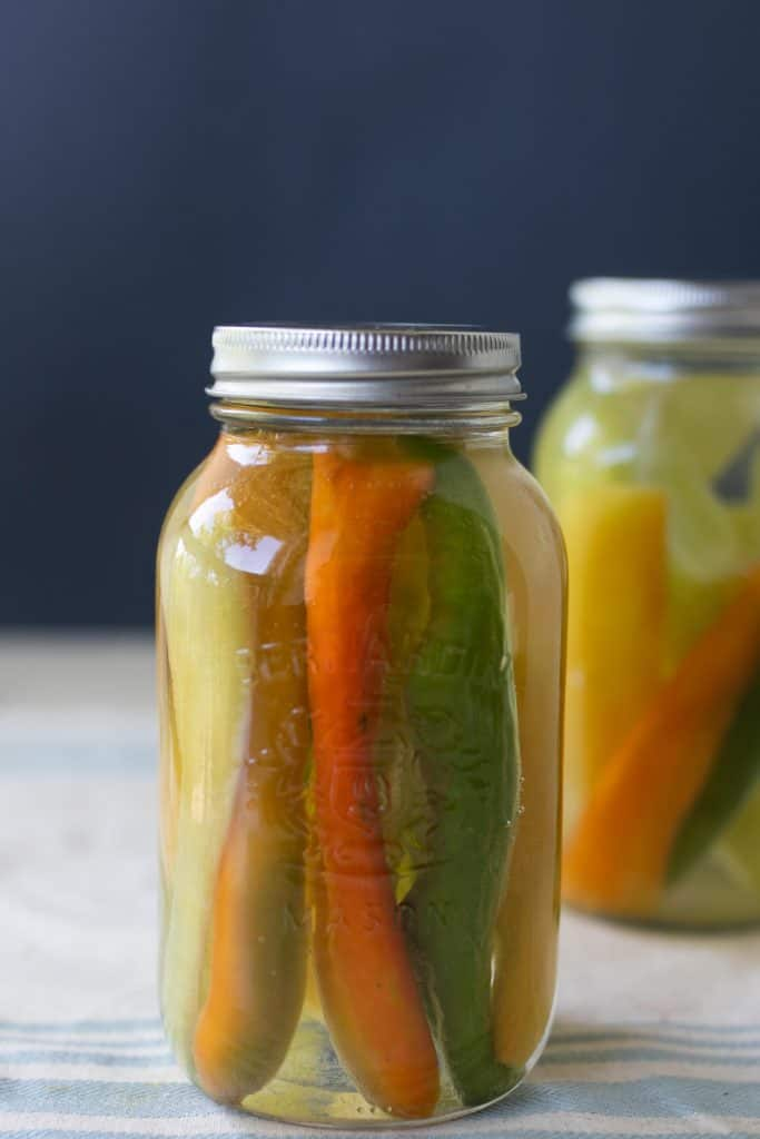 two jars of fermented peppers