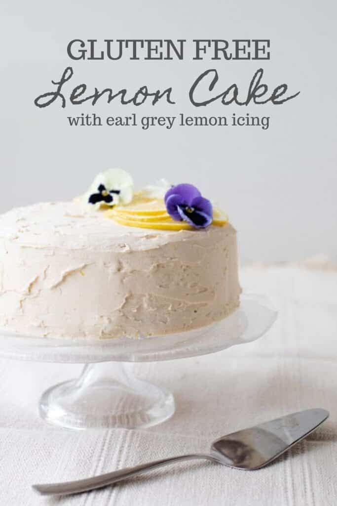 gluten free lemon cake with white lemon and earl grey icing topped with Leons and edible flowers
