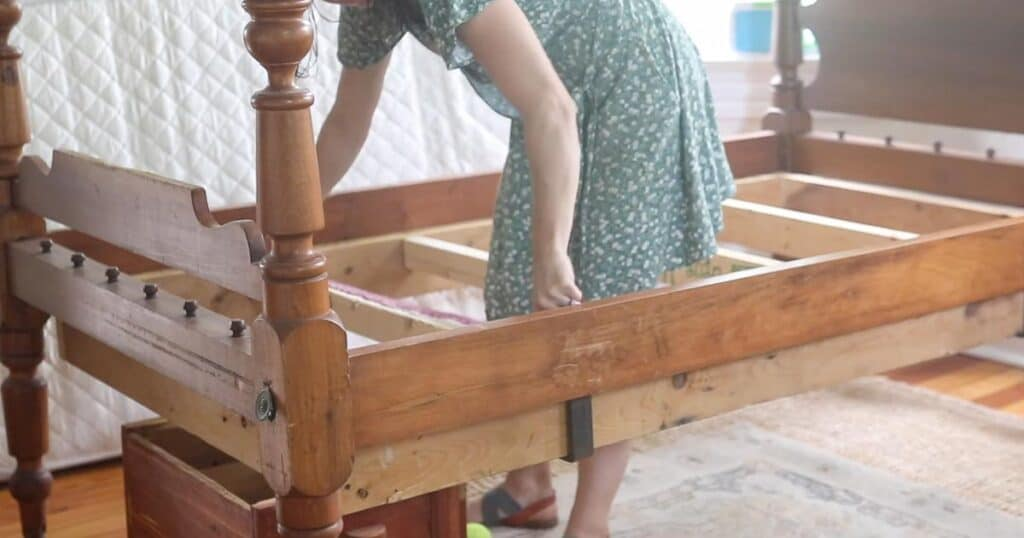 women measuring bed frame