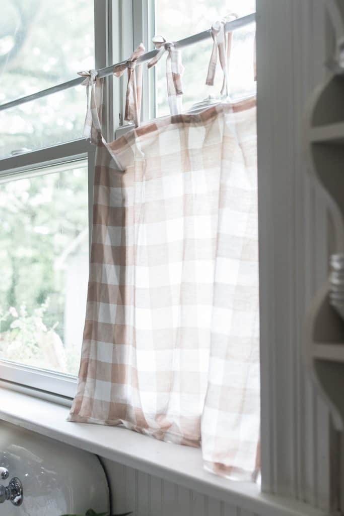 tie top cafe curtains with a peach and cream buffalo check