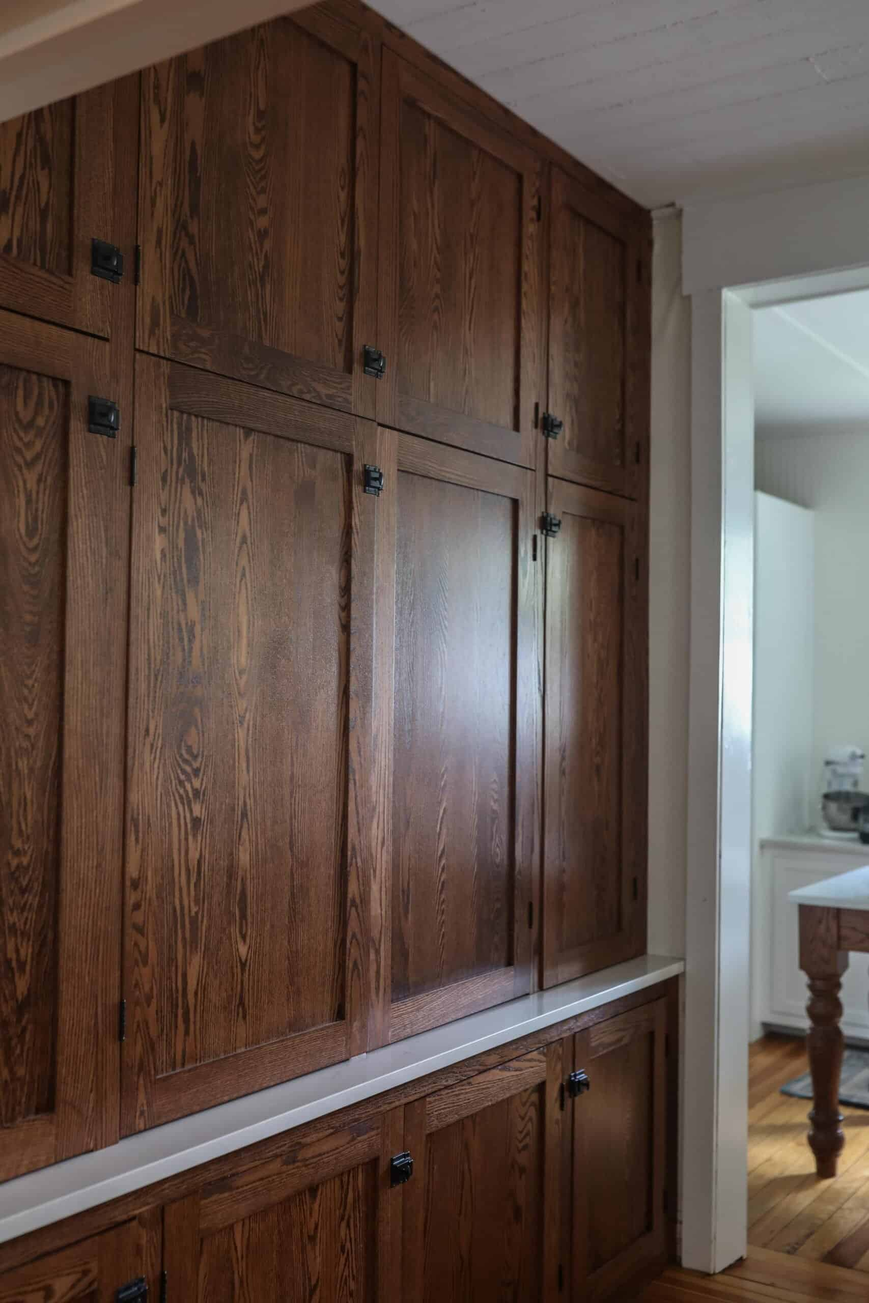 side view of antique looking floor to ceiling cabinets to create an office nook