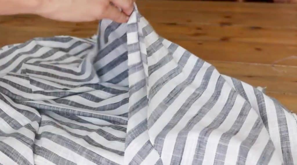 placing a main piece of fabric to attach both of the sleeves to it