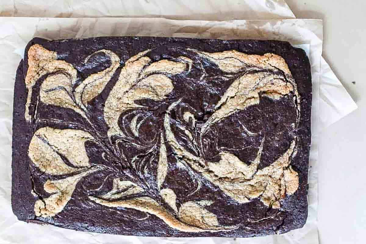 sourdough brownies with a tahini swirl in a baking dish
