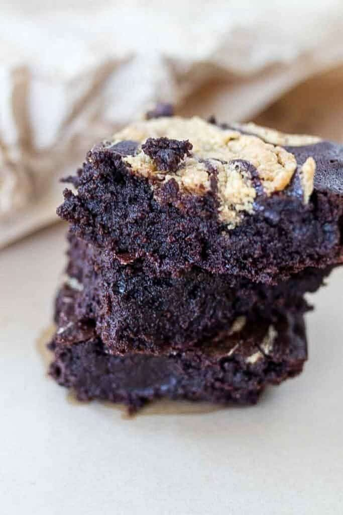 close up of 3 sourdough brownies stacked up