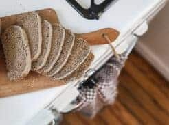 rye bread sliced onto a wood cutting board on an antique stove
