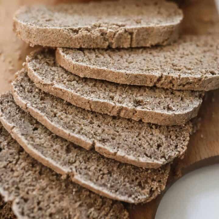sourdough rye bread cut into slices on a wood cutting board