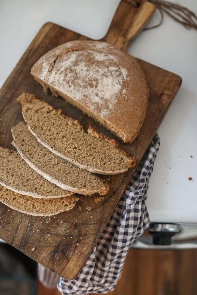 einkorn sourdough bread loaf sliced on a wood cutting board