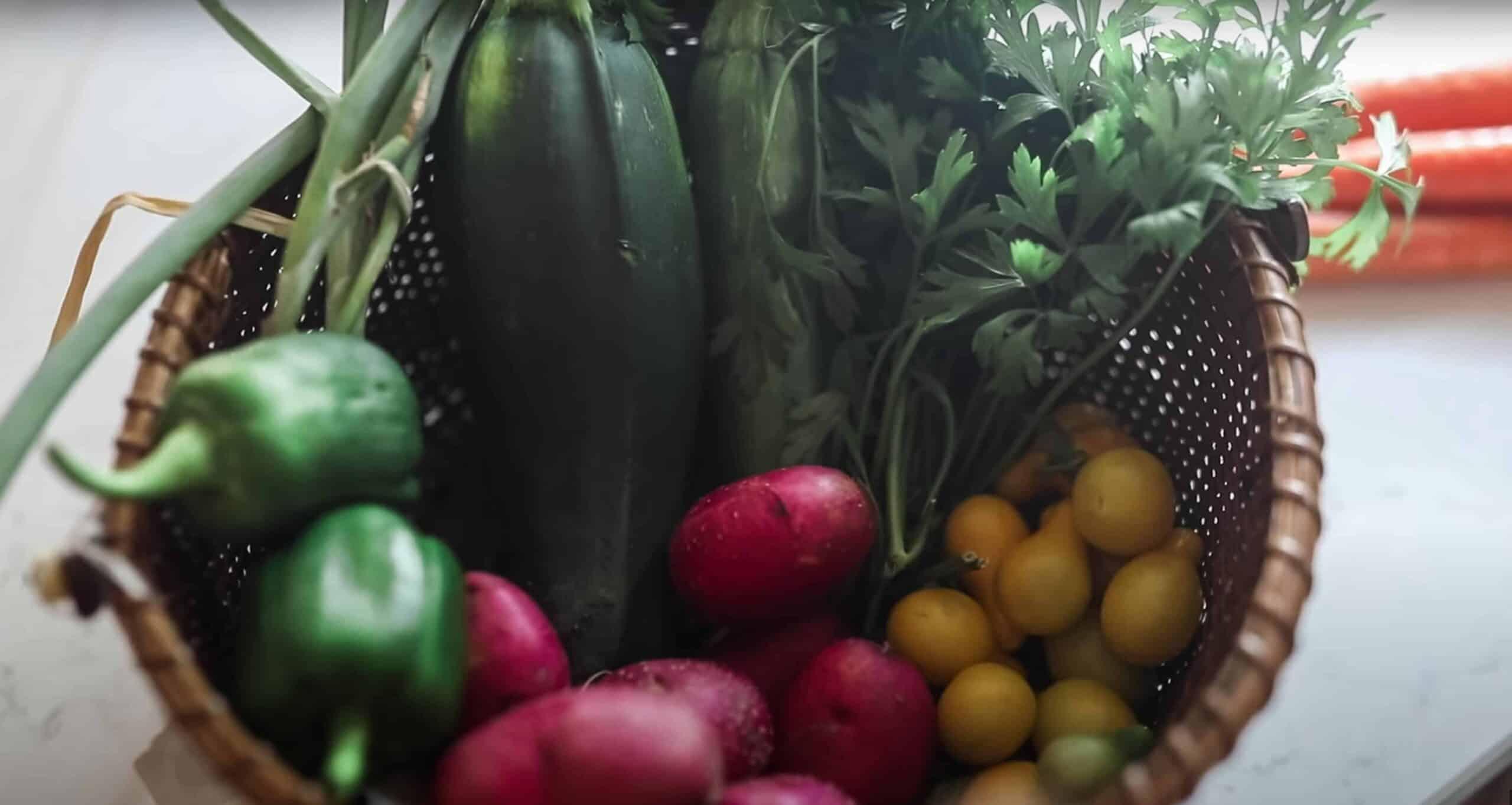bowl of garden veggies on a white countertop