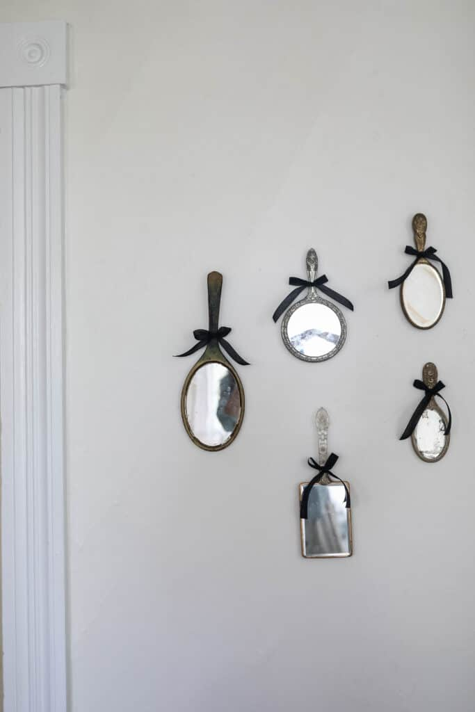 antique mirrors hanging on a wall