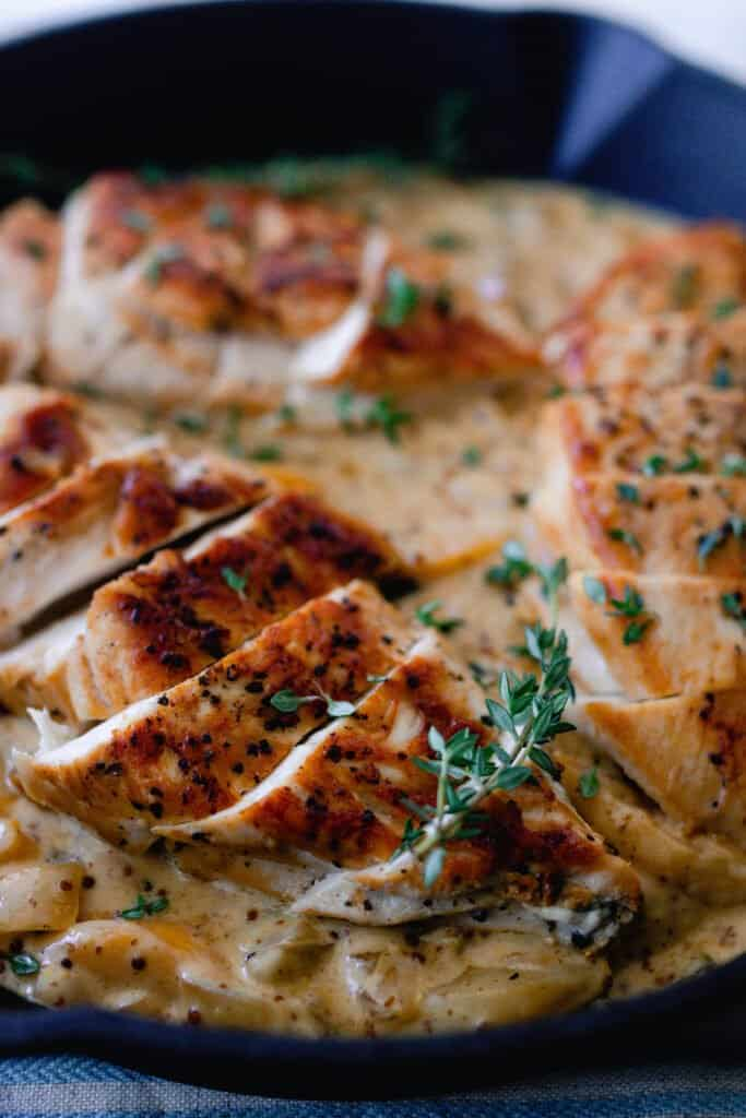 sliced chicken breasts over a creamy white wine peach sauce