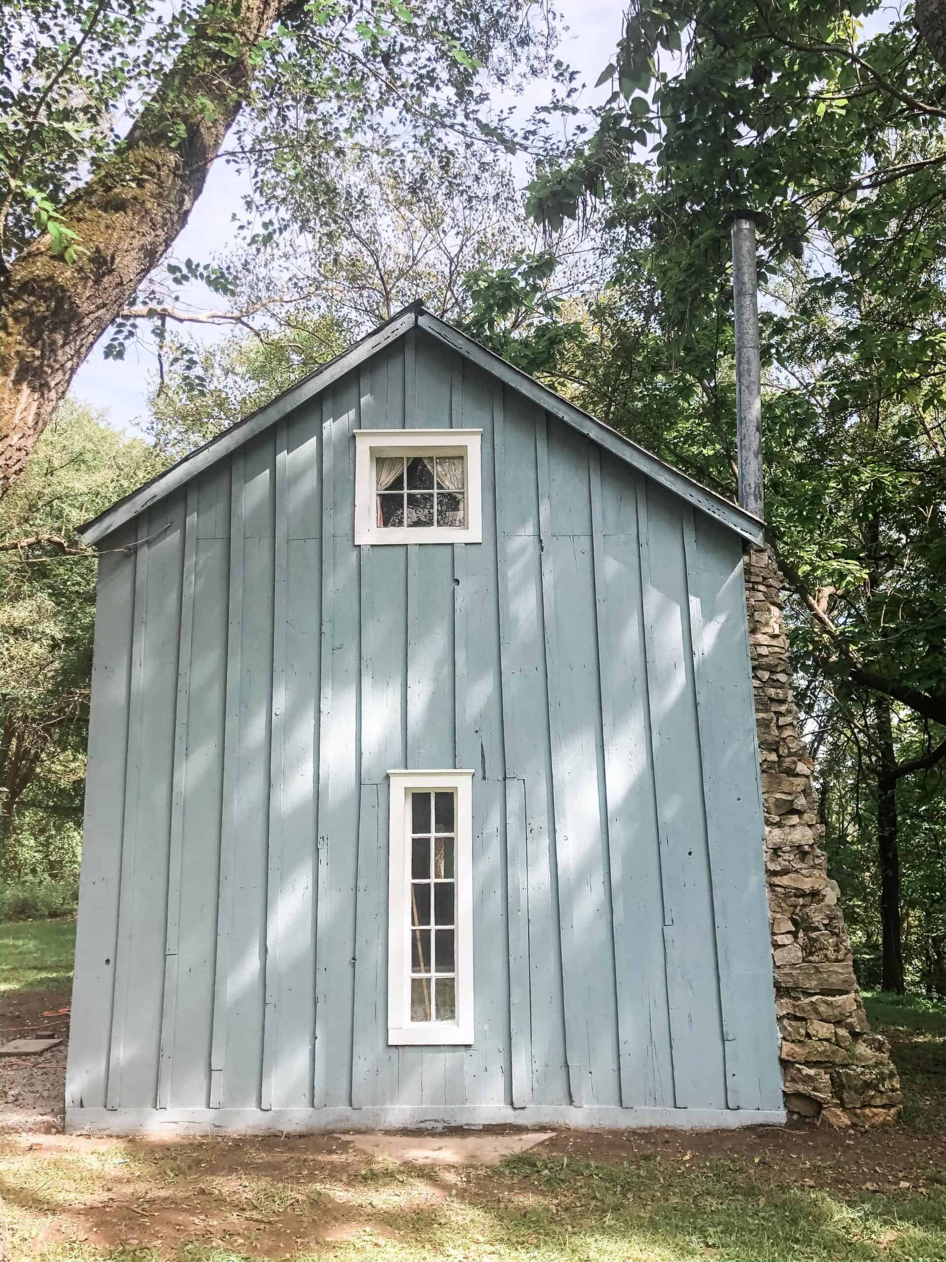 blue cottage with farmhouse window trim