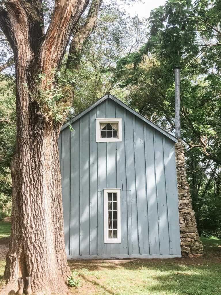 little blue cottage with white farmhouse trim