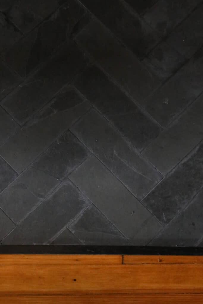 overhead view of slate tile in a herring bone pattern
