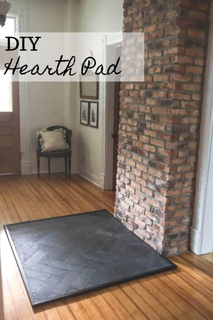 Slate hearth pad for a wood stove with a brick chimney connected.