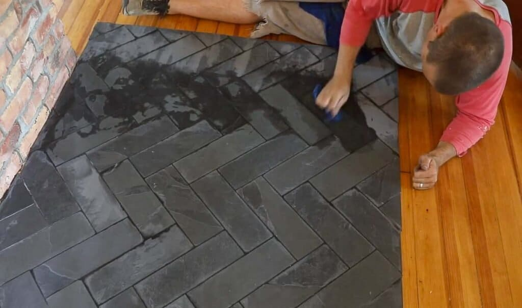 man grouting tile