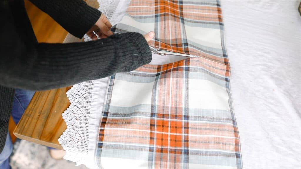 cutting a table runner to create a fall inspired pillow