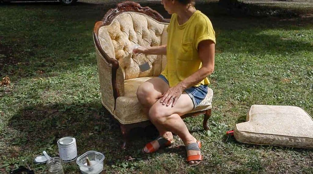 women spraying a chair with water to start chalk painting