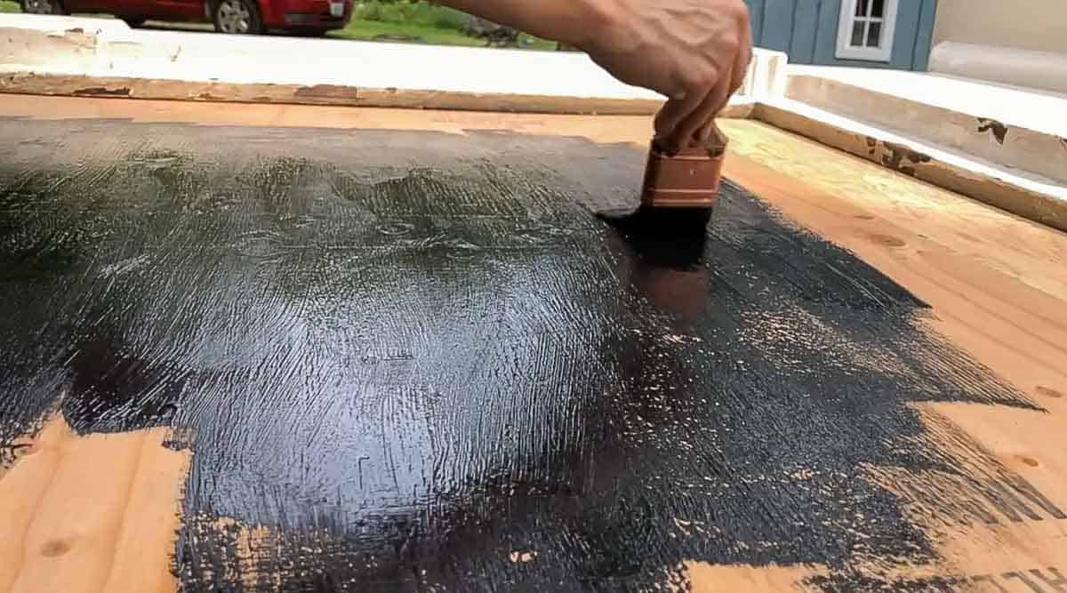 painting plywood black attached to a fireplace mantle