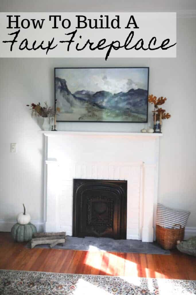 DIY faux fireplace with a vintage mantle and summer cover. A frame Tv sits above the fireplace