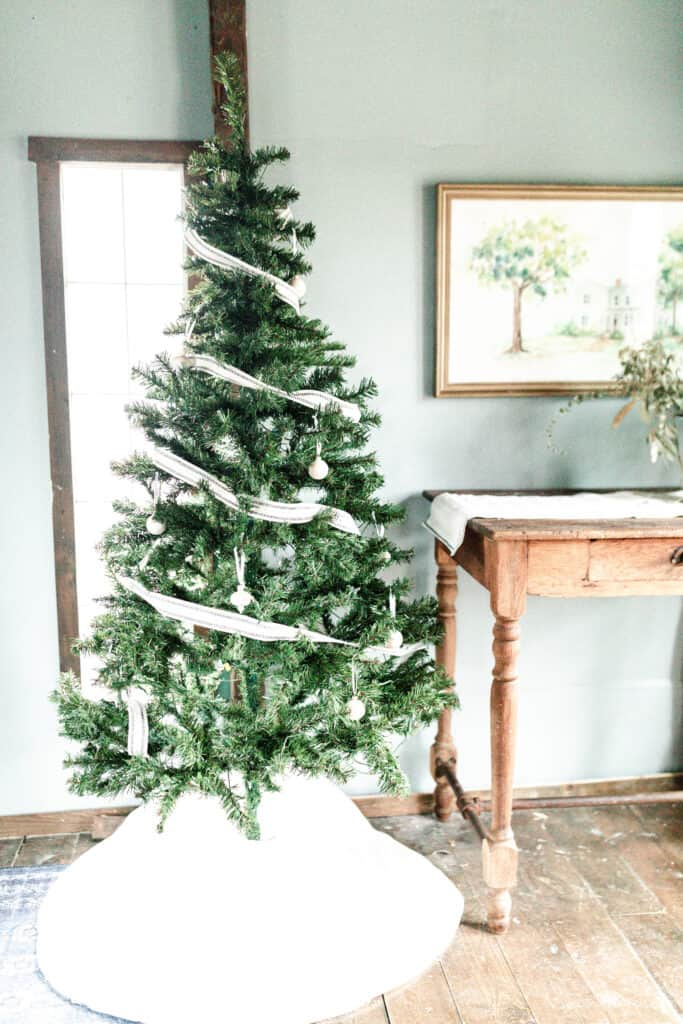 faux Christmas tree with burlap ribbon and whit wooden ornaments