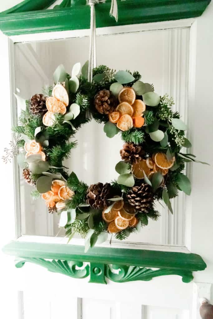 diy Christmas wreath with eucalyptus, oranges, and pine cones