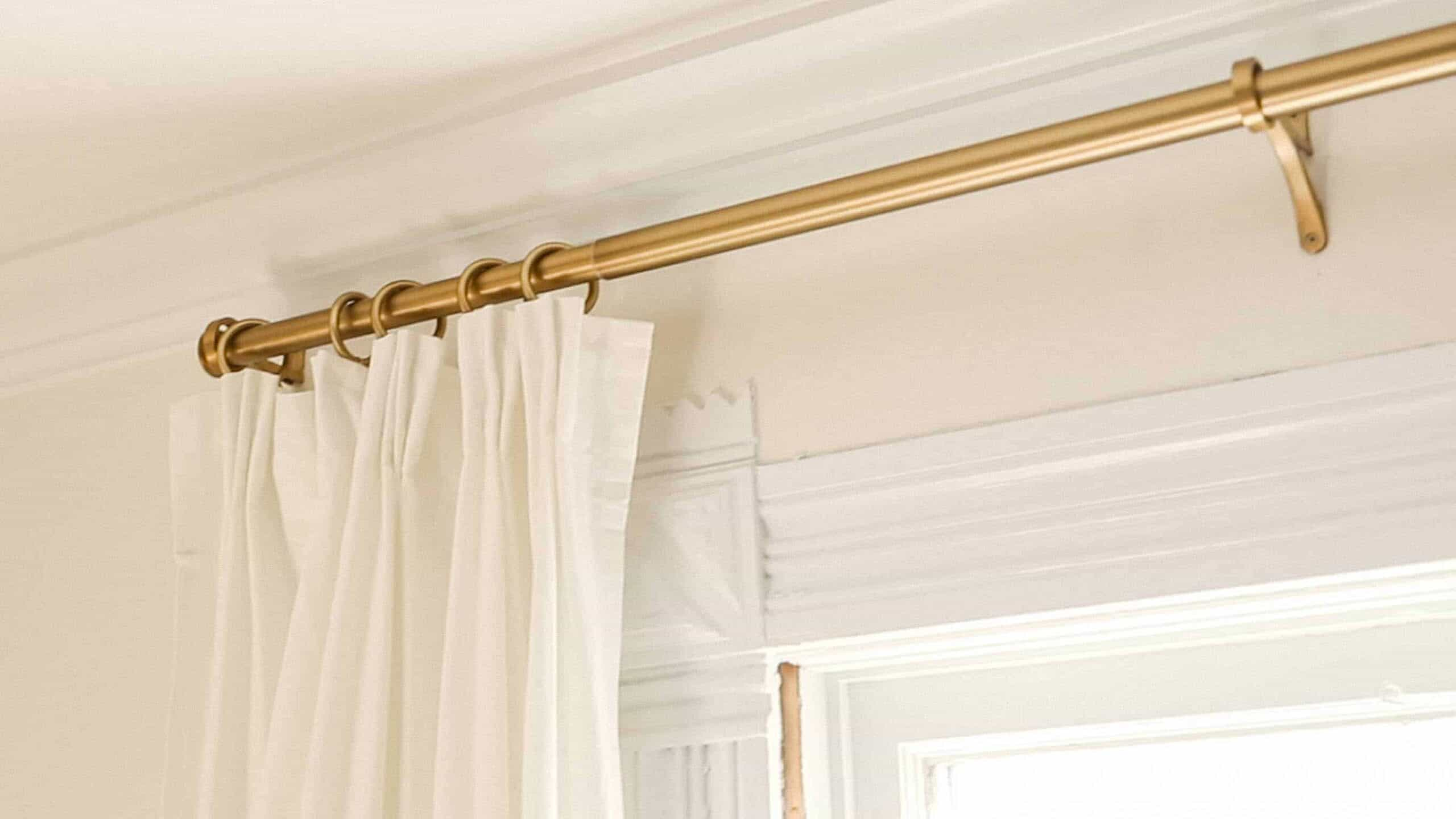 ikea curtain hack using ikea rivta curtains with pleats hung with brass curtain clips on a brass pole