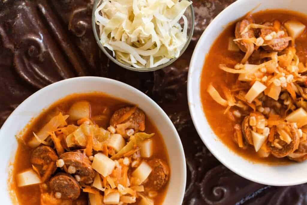 two bowls of sausage sauerkraut soup
