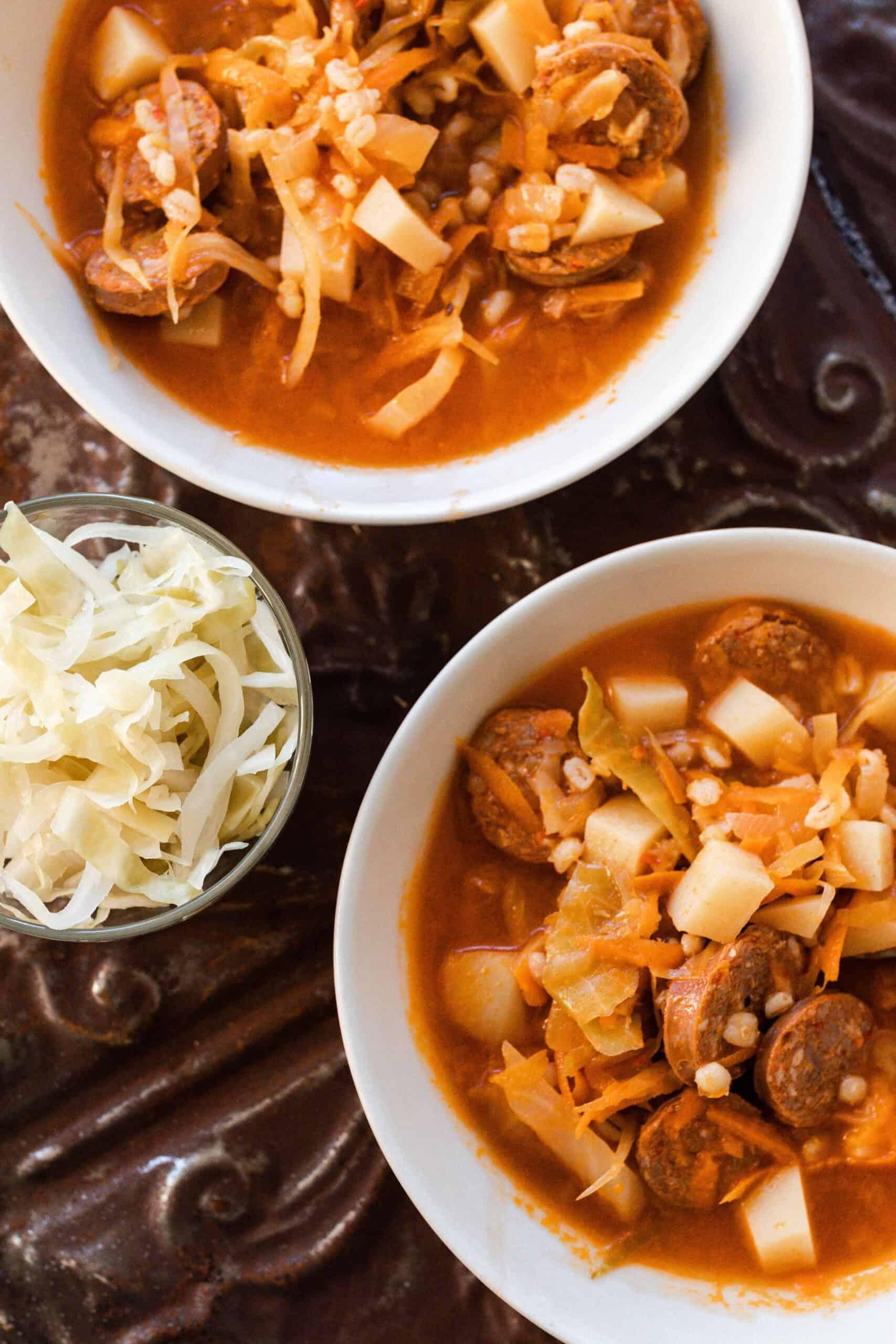 two bowls of sausage sauerkraut soup