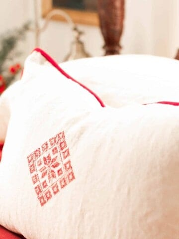 beautiful white an red pillow cases on a victorian style vintage bed with red and white linens