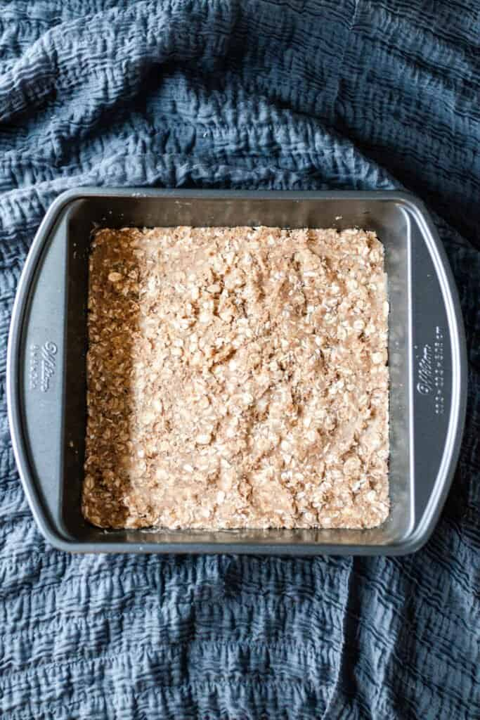 crumble pressed down in the bottom of a pan