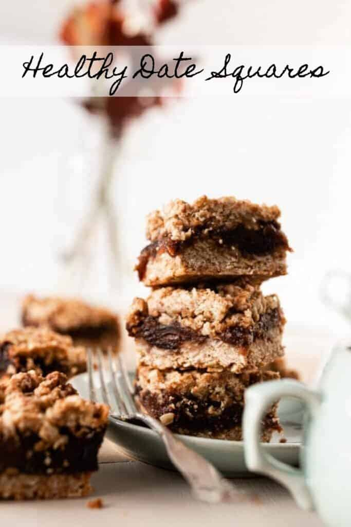 healthy date squares stacked up on a sage plate