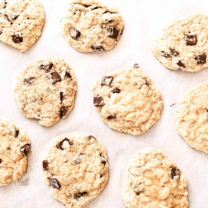 sourdough chocolate chip cookies on parchment paper