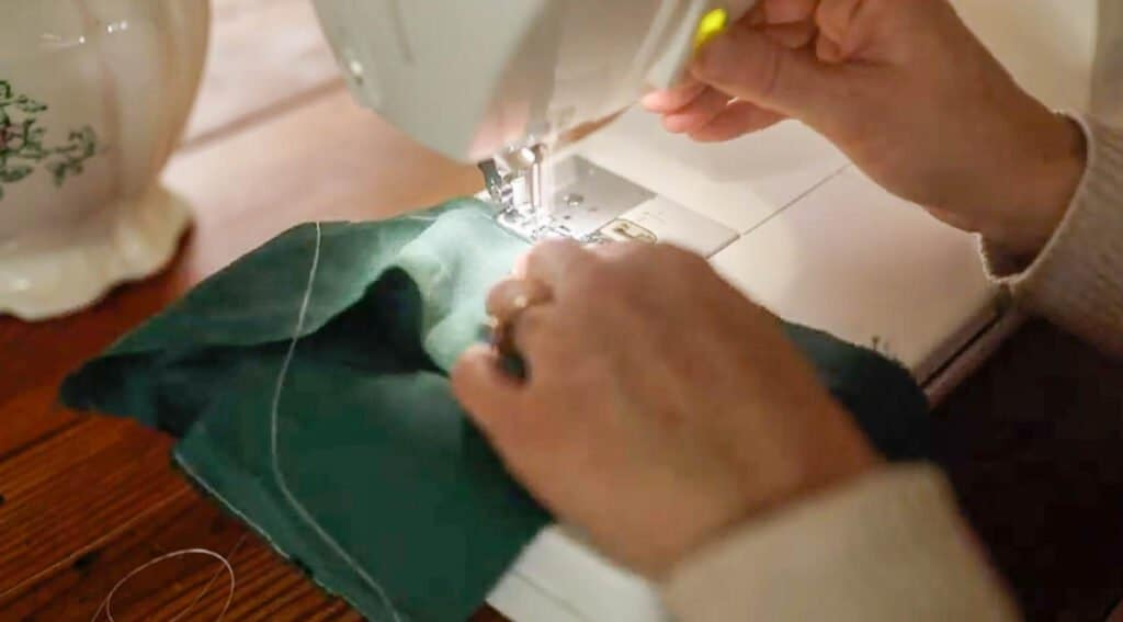 sewing a baby bonnet together on a sewing machine