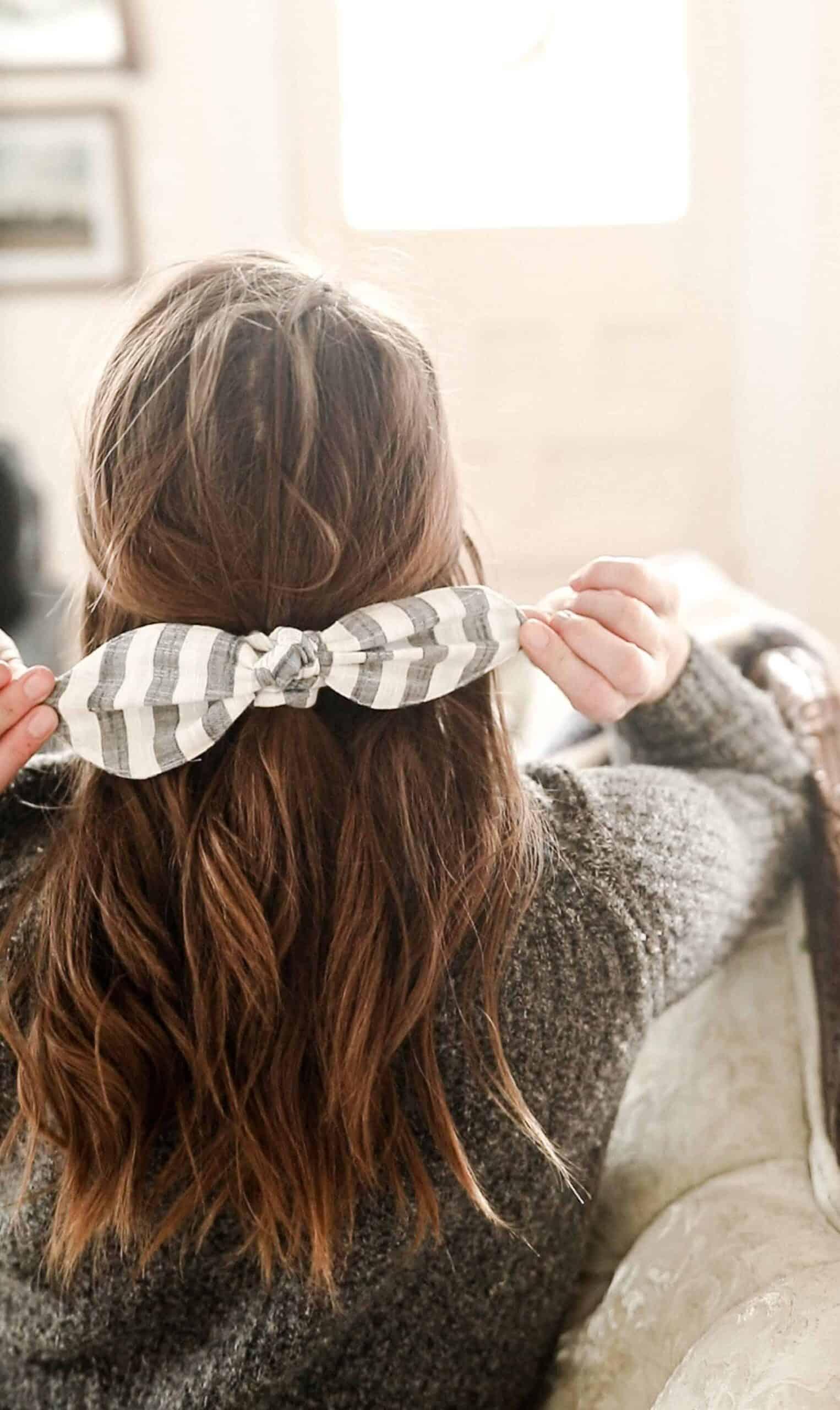women wearing a stripped DIY scrunch bow