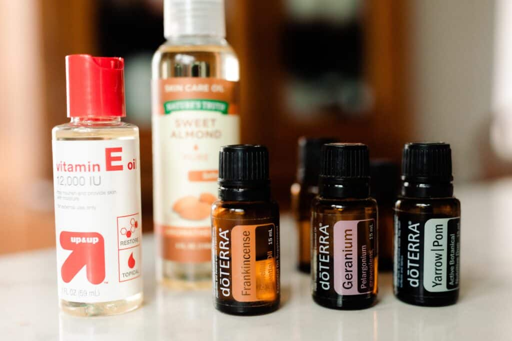 homemade face serum ingredients on a white countertop
