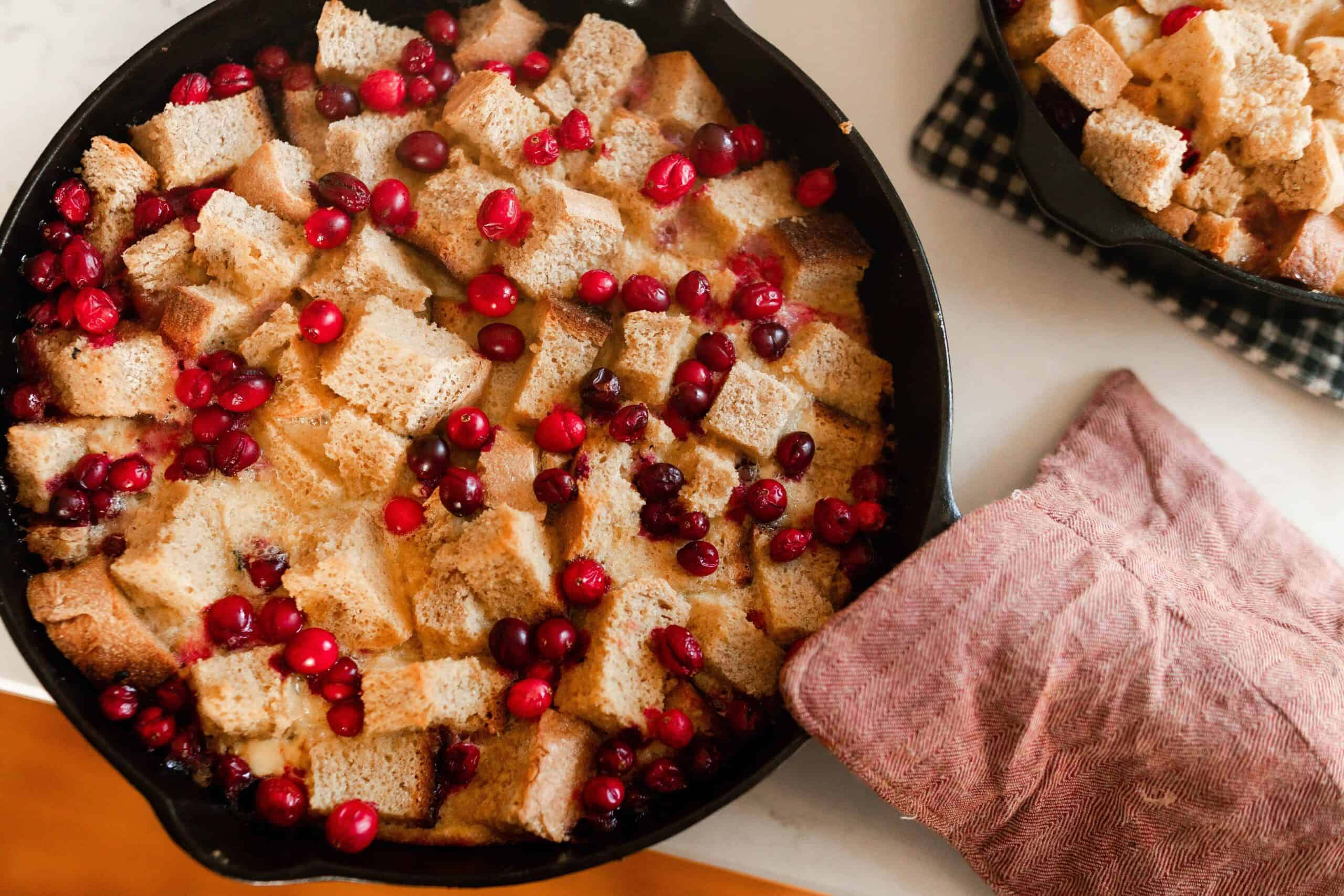 cranberry French toast casserole in a cast iron skillet