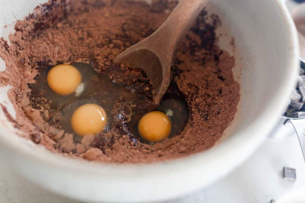 Eggs added into wet ingredients for einkorn brownies