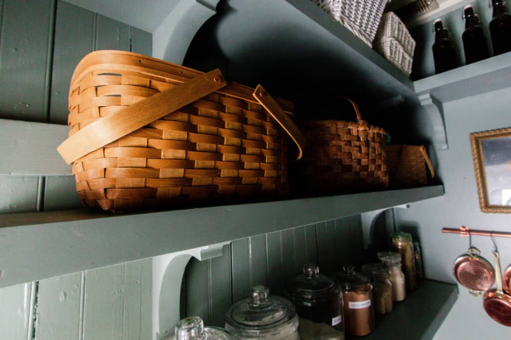 baskets on wooden shelves held up but wooden corbels