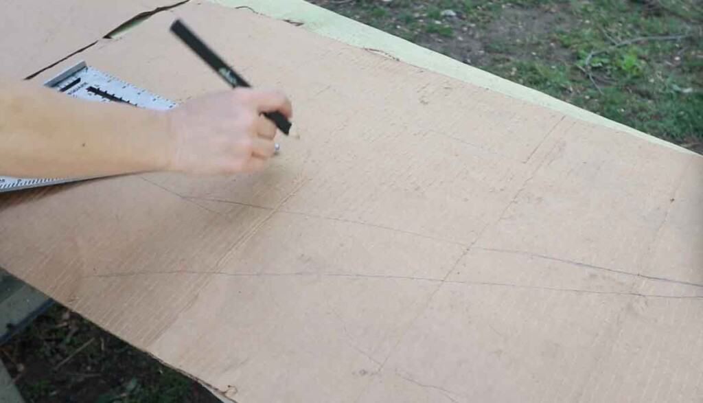 women using a framing square to mark out stair stringers on a piece of card board