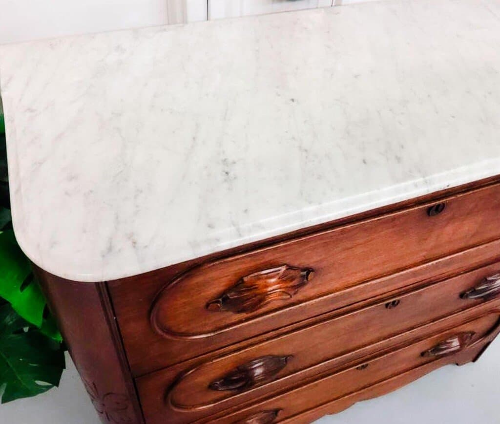 top view of a vintage marble top bed dresser