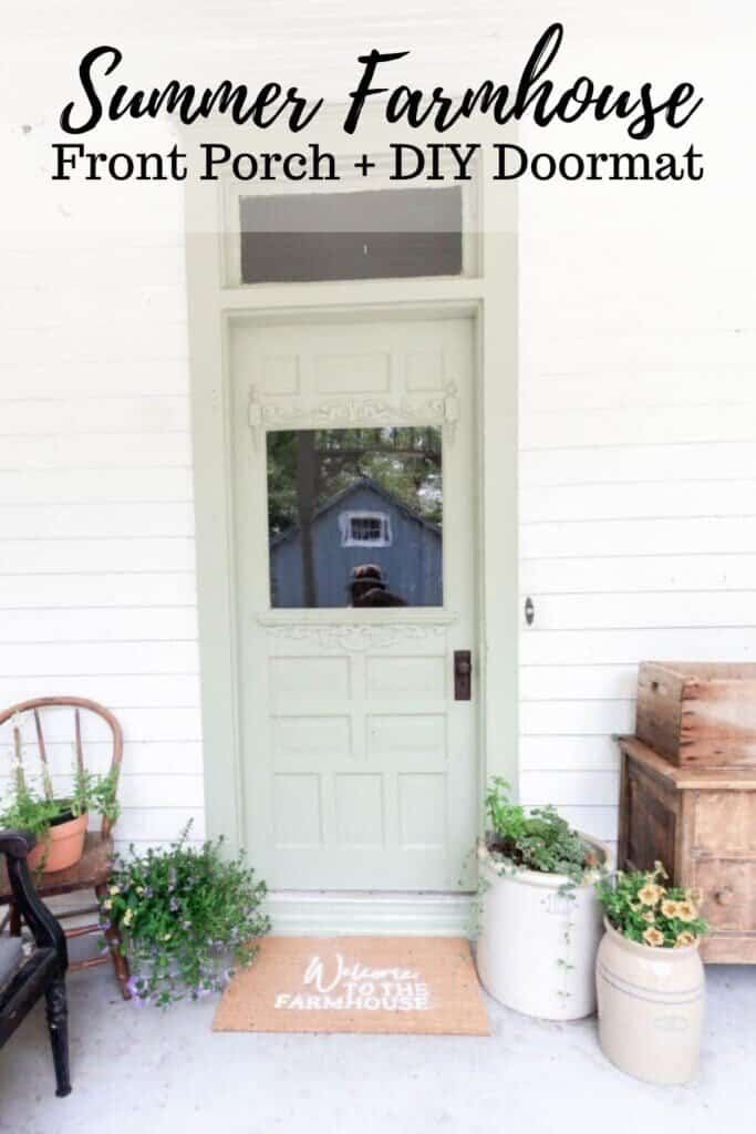 sage green farmhouse front door with a DIY Cricut doormat. Crocks with flowers sit to the right and a antique wooden chair with flowers in a pot on the right of the door